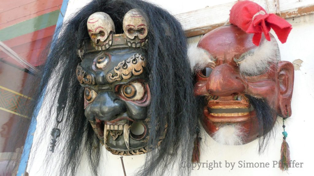 Masks represent deities that occur in sacred dances.